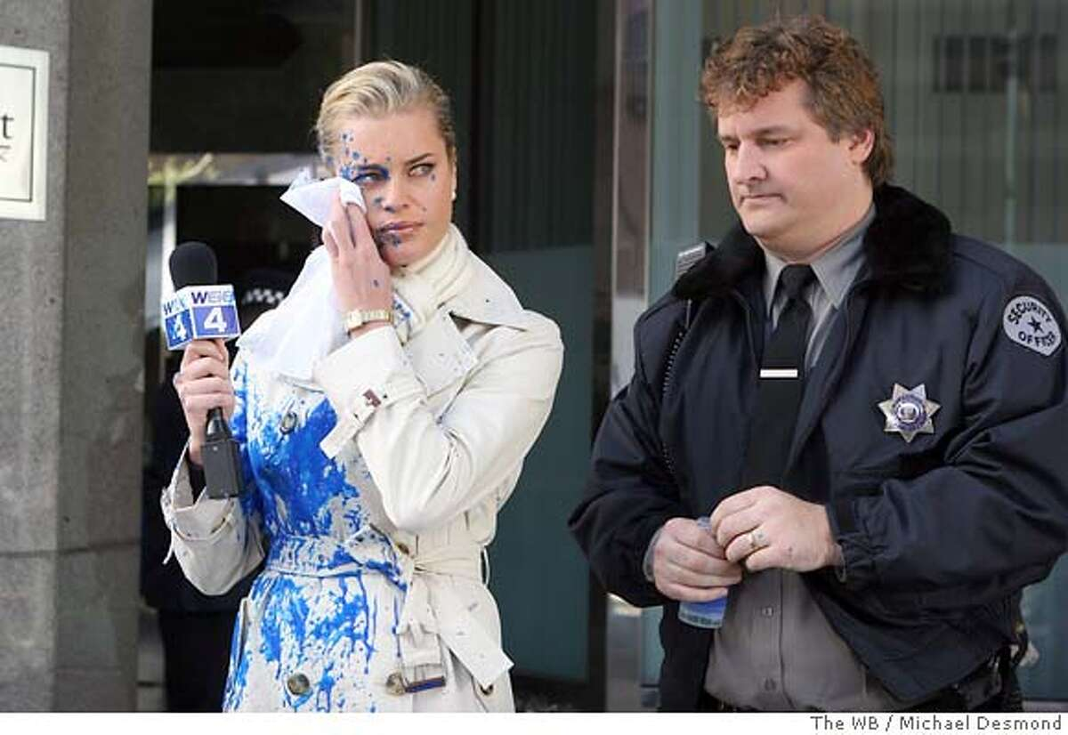 A publicity photograph shows actress Romijn in new comedy television series Pepper Dennis