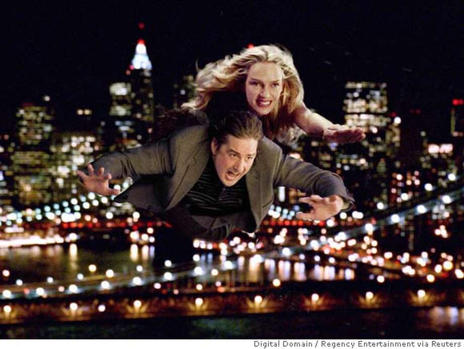 "Actors Uma Thurman (top) and Luke Wilson are shown in a scene from their new film ""My Super Ex-Girlfriend"" in this undated publicity photo released July 19, 2006. Thurman plays the role of a jilted lover - who happens to be a super hero - and uses her powers to exact revenge on her ex. NO ARCHIVE REUTERS/Digital Domain/Regency Entertainment/Handout (UNITED STATES) 0 Photo: Digital Domain/Regency Entertain"