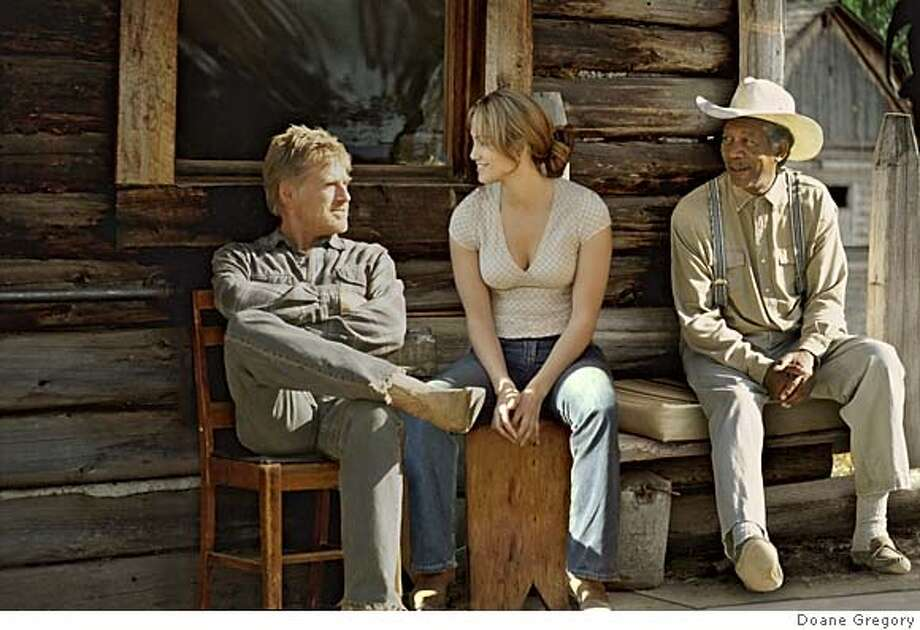 UNFINISHED09 Robert Redford, Jennifer Lopez and Morgan Freeman in Lasse Hallstrom's AN UNFINISHED LIFE. Photo courtesy of Doane Gregory. Miramax Films Ran on: 09-09-2005  Robert Redford, left, Jennifer Lopez and Morgan Freeman mark time in Lasse Hallstrom's movie of little moments. Photo: Doane Gregory
