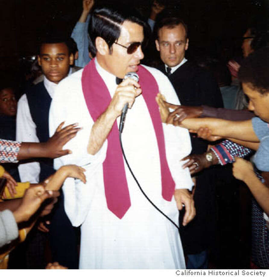 "Jim Jones in white robe and sunglasses being touched by members of the Peoples Temple in Los Angeles, CA in 1974. He is the subject of Stanley Nelson's new documentary ""Jonestown: The Life and Death of Peoples Temple,"" opening Friday. Credit: California Historical Society  Ran on: 10-29-2006  Sacha Baron Cohen (center), starring as the title character in &quo;Borat,&quo; is a Kazakhstani reporter who leaves his homeland to make a documentary in America. The movie opens Friday.  Ran on: 11-03-2006  Jim Jones, who followers thought could heal them, is touched by members of the Peoples Temple in Los Angeles in 1974. Photo: California Historical Society"