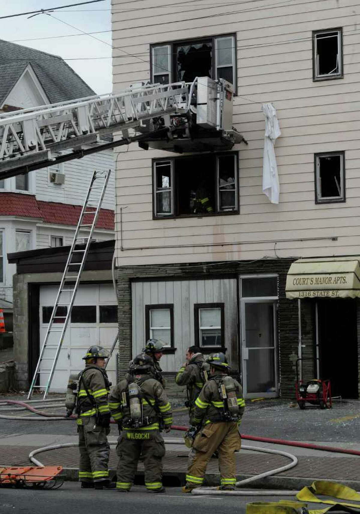 Schenectady firefighters are near the Court's Manor Apartments at 1316 State St. in Schenectady, N.Y. after fire forced residents from the building on Wednesday, Feb. 15, 2012. (Skip Dickstein / Times Union)