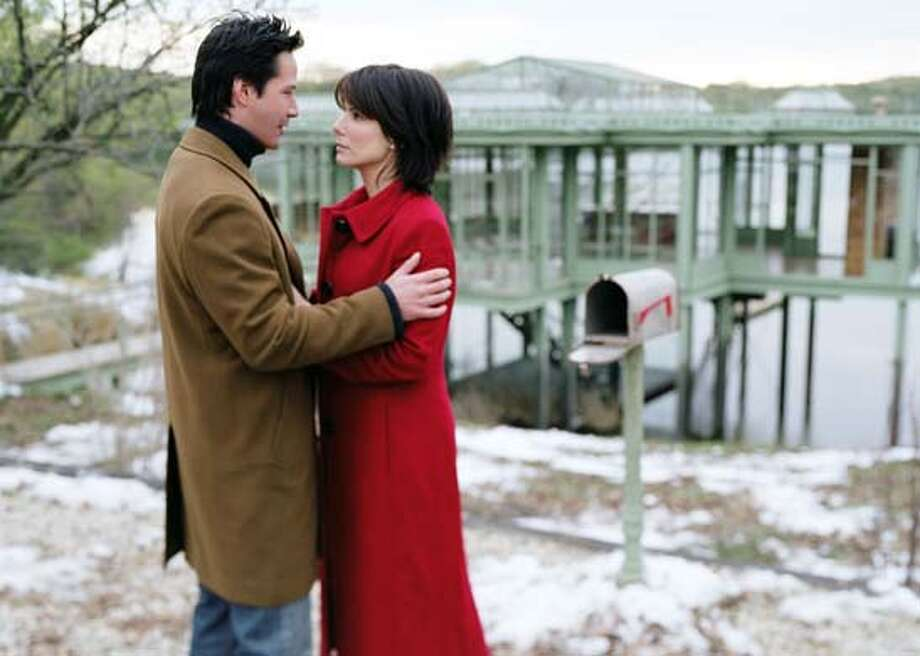 Actors Sandra Bullock and Keanu Reeves in scene from 'The Lake House' undated publicity photograph Photo: WARNER BROS