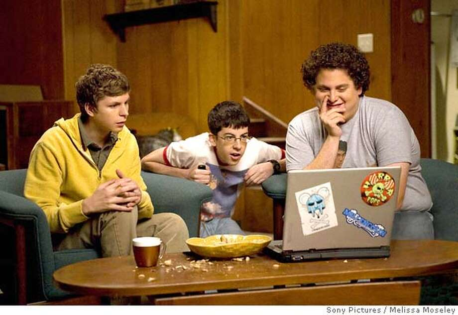 SB-189 : Evan (Michael Cera, left), Fogell (Christopher Mintz-Plasse, center), and Seth (Jonah Hill, right), can have the night they�ll remember for the rest of their lives in Superbad, the new film from producers Judd Apatow and Shauna Robertson (The 40-Year-Old Virgin), screenwriters Seth Rogen & Evan Goldberg, and director Greg Mottola. Photo Credit : Melissa Moseley. Photo: Melissa Moseley SMPSP