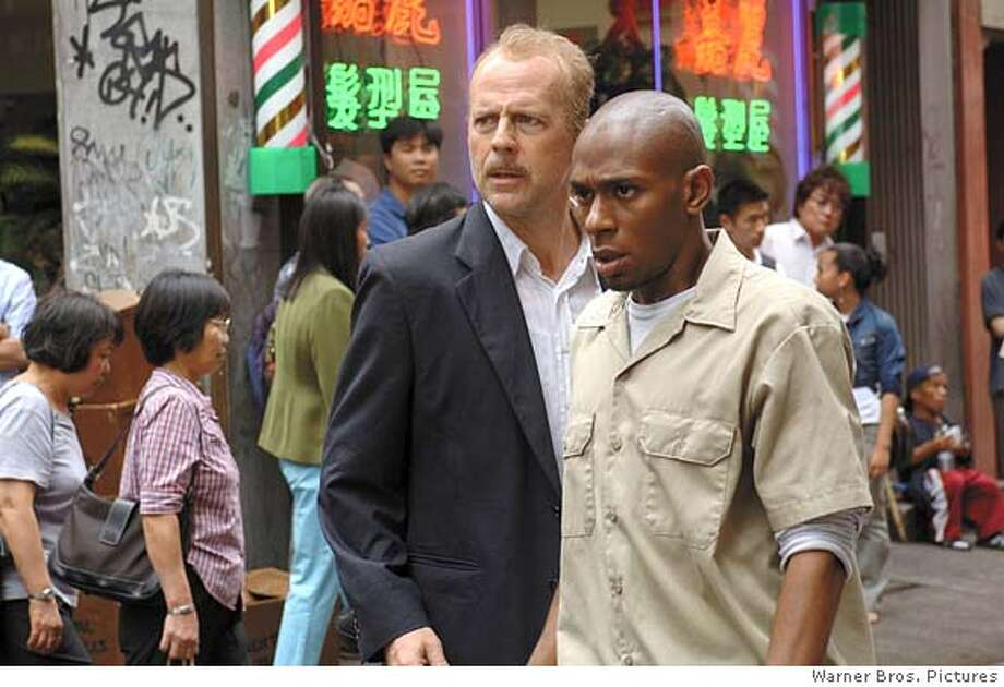 BRUCE WILLIS as Jack Mosley and MOS DEF as Eddie Bunker star in Alcon Entertainment and Millennium Films� action thriller 16 Blocks, also starring David Morse and distributed by Warner Bros. Pictures.  PHOTOGRAPHS TO BE USED SOLELY FOR ADVERTISING, PROMOTION, PUBLICITY OR REVIEWS OF THIS SPECIFIC MOTION PICTURE AND TO REMAIN THE PROPERTY OF THE STUDIO. NOT FOR SALE OR REDISTRIBUTION. Photo: Barry Wetcher