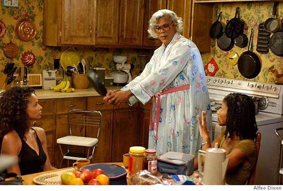Madea (Tyler Perry, center) with Lisa (Rochelle Aytes, left) and Vanessa (Lisa Arrindell Anderson) in TYLER PERRY'S MADEA'S FAMILY REUNION. Photo credit: Alfeo Dixon Photo: Alfeo Dixon