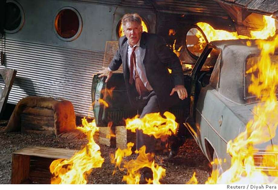 "Actor Harrison Ford is shown in this undated publicity photo escaping from a car on fire as he chases the bank robbers who have kidnapped his family for the film ""Firewall"" released by Warner Brothers on February 3, 2006. Ford plays Jack Stanfield, an electronic security specialist, who is forced to rob the bank he works for in order to pay off his family's ransom. The movie opens in the U.S. on February 10. NO ARCHIVES. REUTERS/Diyah Pera/Warner Brothers/Handout 0 Photo: HO"