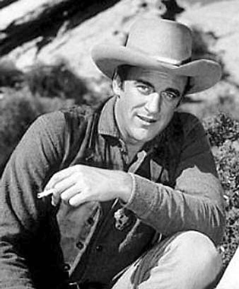 "Jim Arness plays Marshal Matt Dillon in ""Gunsmoke."""
