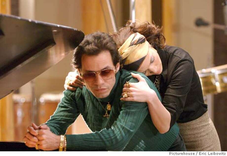 (NYT69) UNDATED -- July 31, 2007 -- FILM-ICHASO-ADV29 -- Marc Anthony and Jennifer Lopez, in a scene from ''El Cantante.'' It is that euphoric feeling of being liberated by art and raw talent while struggling to remain true to one's roots that director Leon Ichaso set out to capture in films like the highly acclaimed ''Crossover Dreams'' and ''Pinero,'' and ''El Cantante,'' based on the life of Hector Lavoe, a popular Puerto Rican salsero who died of AIDS at 46 in 1993. (Eric Leibowitz/Picturehouse via The New York Times)**ONLY FOR USE WITH STORY BY MIRTA OJITO SLUGGED: FILM-ICHASO. ALL OTHER USE PROHIBITED. **ONLY FOR USE WITH STORY BY MIRTA OJITO SLUGGED: FILM-ICHASO. ALL OTHER USE PROHIBITED. Photo: Eric Liebowitz/Picturehouse