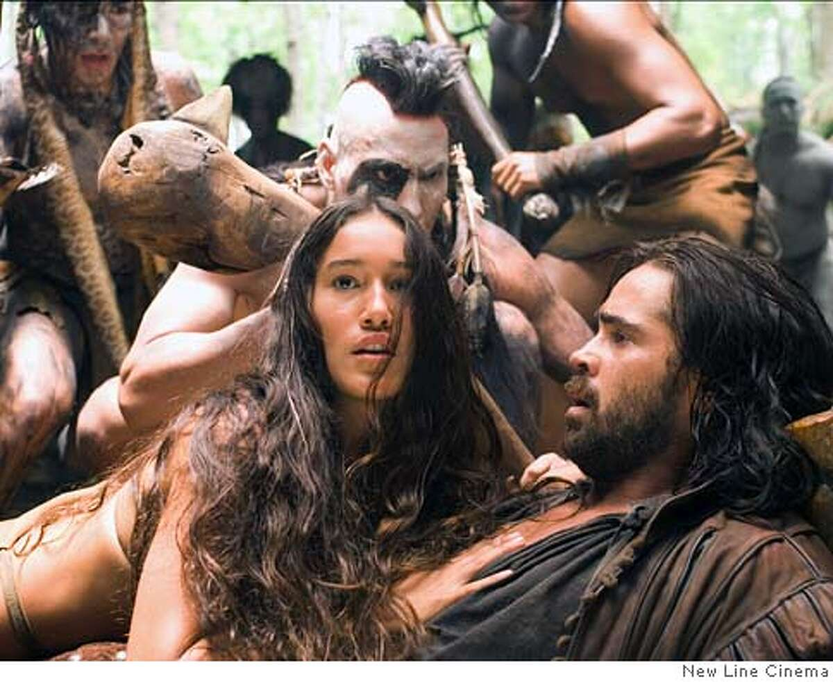 Q�orianka Kilcher as �Pocahontas� protects Colin Farrell as �Captain John Smith� in New Line Cinema�s upcoming film, The New World. The New World
