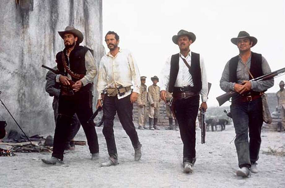 "BEN JOHNSON (LEFT), WARREN OATES, WILLIAM HOLDEN AND ERNEST BORGNINE ARE ""THE WILD BUNCH."" IN THE MOVIE OF THE SAME NAME. CAT Photo: Handout"