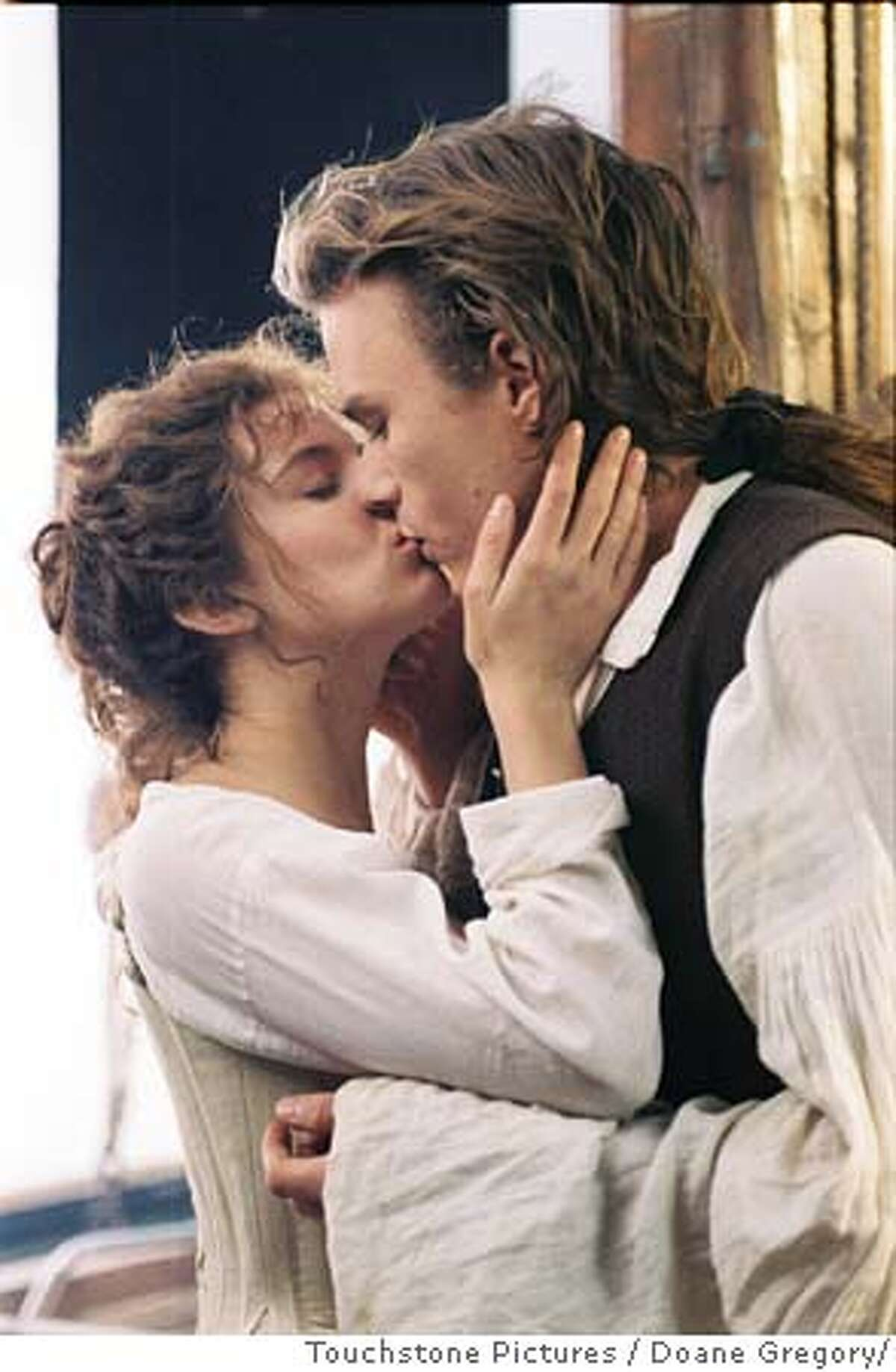 Actor Heath Ledger, who plays the role of Casanova, kisses co-star Sienna Miller in a scene from the new film 'Casanova' in this undated publicity photograph. The film opens in limited release in the United States December 25, 2005. NO ARCHIVES REUTERS/Doane Gregory/Touchstone Pictures/Handout 0