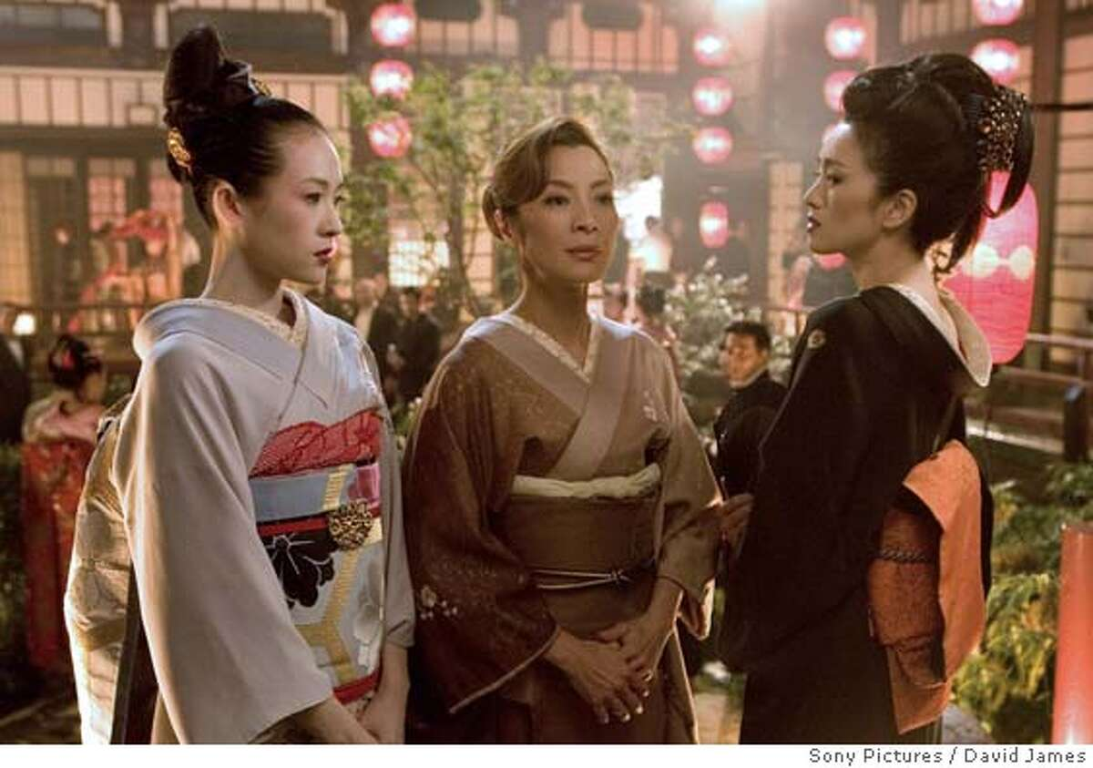 """In this photo released by Sony Pictures, actresses, from left, Ziyi Zhang, Michelle Yeoh and Gong LI appear a scene from the new film, """"Memoirs of a Geisha."""" The filmmakers find themselves defending their decision to look beyond Japan, where the film takes place, when they searched for their leading ladies. Zhang and Gong are Chinese, and Yeoh is Malaysian-Chinese. (AP Photo/Sony Pictures, David James)"""