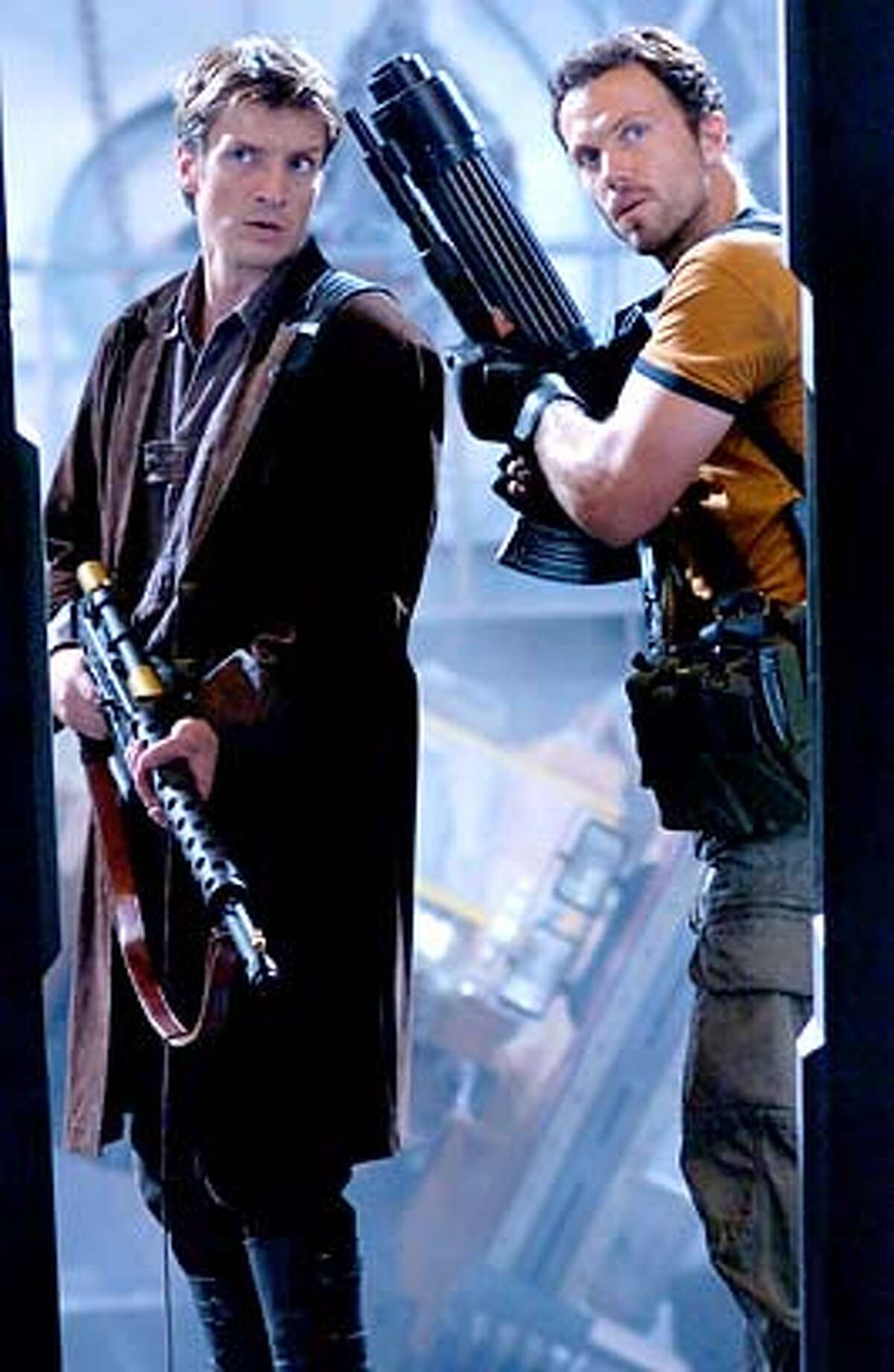 """Handout photo for the sci-fi movie """"Serenity."""" Left is Nathan Fillion as Captain Malcolm Reynolds, right is Adam Baldwin as Jayne (no first name given)."""