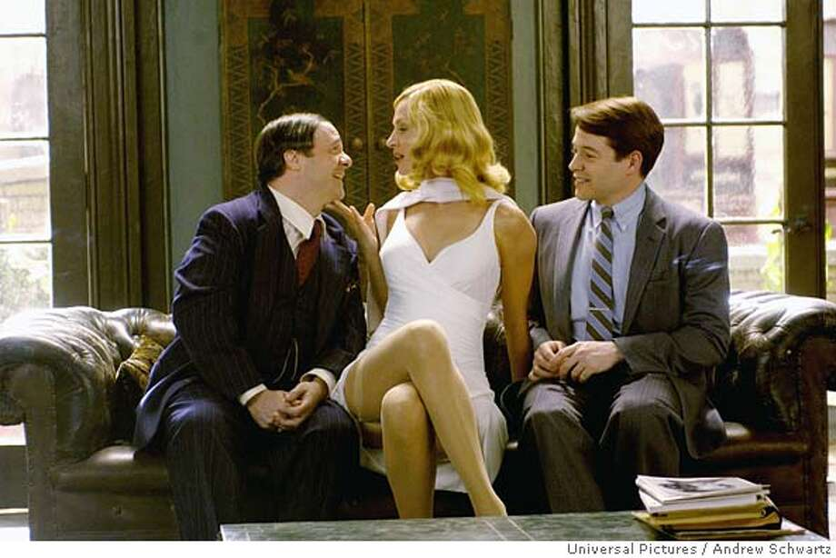 """In this photo provided by Universal Pictures, Nathan Lane and Matthew Broderick recreate their Broadway roles as Max Bialystock and Leo Bloom and are joined by Uma Thurman as Ulla in the movie musical version of Mel Brooks' Broadway musical, """"The Producers."""" (AP Photo/Universal Pictures/Andrew Schwartz) Photo: ANDREW SCHWARTZ."""