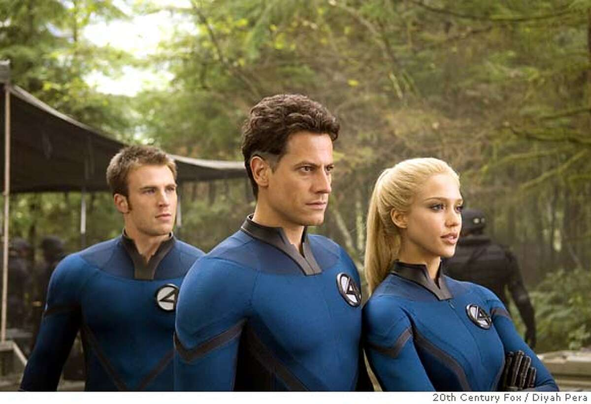 Johnny Storm (Chris Evans), Reed Richards (Ioan Gruffudd) and Sue Storm (Jessica Alba) plot their next move as the attempt to unravel the mystery of the Silver Surfer. (20th Century Fox / Diyah Pera)