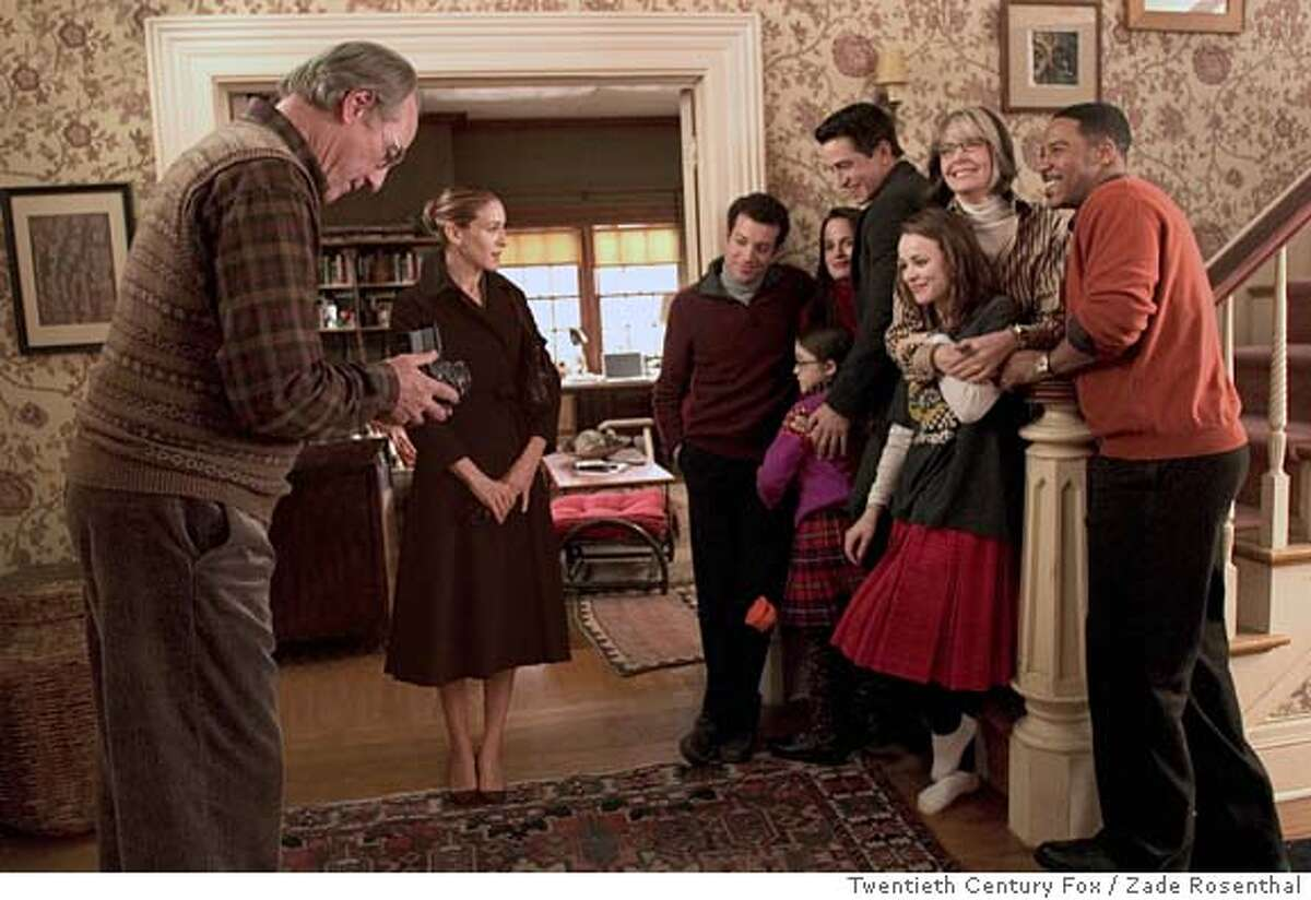 In this photo provided by Twentieth Century Fox, Meredith (Sarah Jessica Parker) feels like an outsider when Stone patriarch Kelly (Craig T. Nelson) takes a family photo of, left to right: Thad Stone (Ty Giordano), Elizabeth Trousdale (Savannah Stehlin), Susannah Stone Trousdale (Elizabeth Reaser), Everett Stone (Dermot Mulroney), Amy Stone (Rachel McAdams), Sybil Stone (Diane Keaton) and Thads companion, Patrick Thomas (Brian White), in