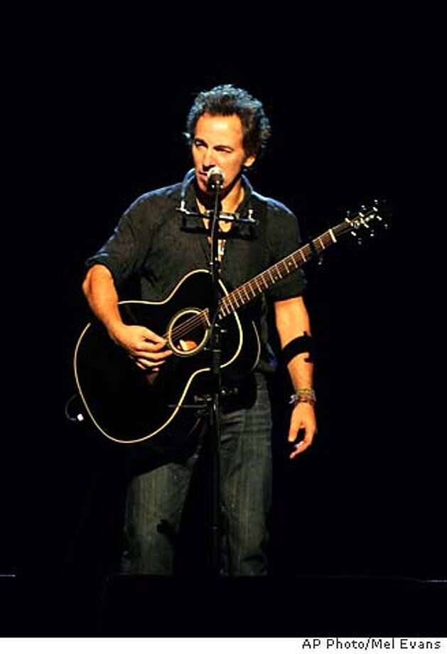Bruce Springsteen asks the crowd to be as quiet as possible while he performs at the Sovereign Bank Arena in Trenton, N.J., Monday, Nov. 21, 2005. (AP Photo/Mel Evans) STAND ALONE PHOTO Photo: MEL EVANS