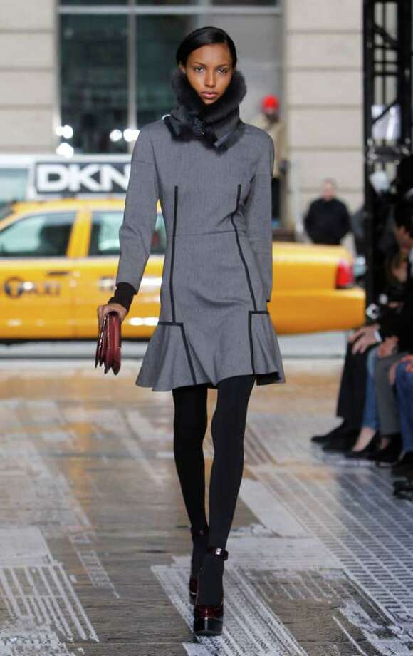 The DKNY fall 2012 collection is modeled Sunday during Fashion Week in New York.  Photo: Jason DeCrow, Associated Press / FR103966 AP