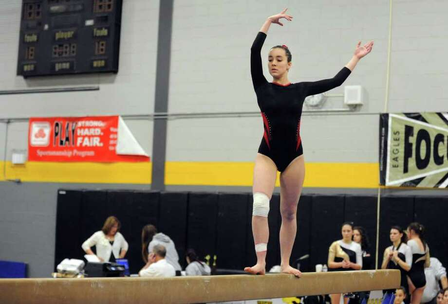 New Canaan's Ellen Hoover competes on beam Saturday, Feb. 11, 2012 during the FCIAC gymnastics championships at Jonathan Law High School in Milford, Conn. Photo: Autumn Driscoll / Connecticut Post