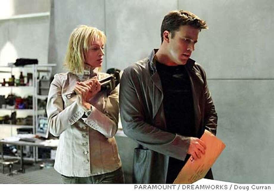 "(Left to right) Uma Thurman as Rachel and Ben Affleck as Jennings in ""Paycheck."" (AP Photo/ PARAMOUNT/DREAMWORKS / Doug Curran) Photo: DOUG CURRAN"