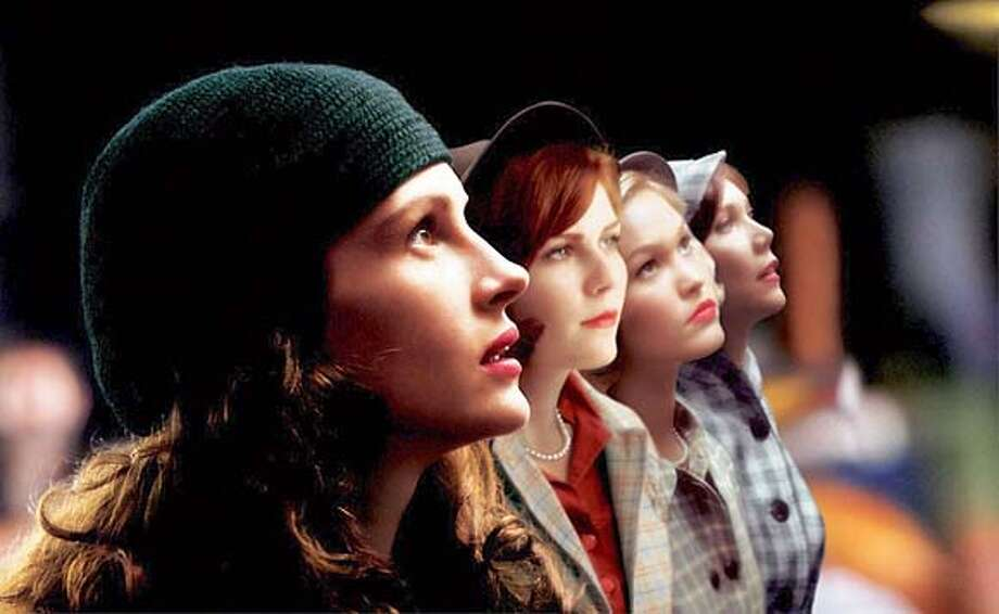 MONA LISA SMILE.jpg  In Revolution Studios' Mona Lisa Smile, Julia Roberts leads an all-star cast of prominent young actresses including Kirsten Dunst, Julia Stiles, Maggie Gyllenhaal and newcomer Ginnifer Goodwin, in a story of women struggling to define themselves in a world that has already defined them. Katherine Watson (Roberts) travels from California to the New England campus of Wellesley College, in the fall of 1953, to teach art history. In the post-war era, Katherine expects that her students, the best and the brightest in the country, will take advantage of the opportunities presented to them. Soon after her arrival, however, Katherine discovers that the environment at the prestigious institution is steeped in conformity. According to their poise and elocution, teacher Nancy Abbey (Marcia Gay Harden), an engagement ring on a young woman's finger is considered a bigger prize than a well-rounded education.
