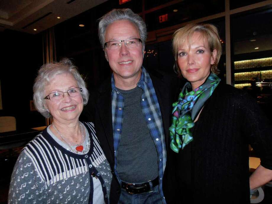 Bette Foster, left, son Radney Foster and daughter Abby Tolin enjoy the success of a reception and concert raising money for the John Radney Foster Service Scholarship at St. Luke's Episcopal School. Photo: Nancy Cook-Monroe, For The Express-News