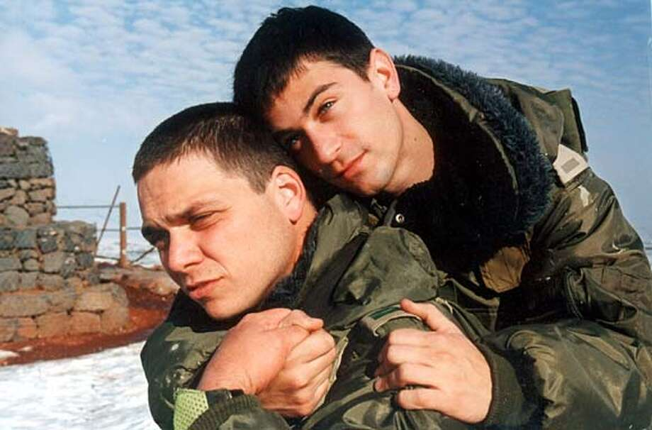YOSSI21.jpg  Yossi (Ohad) and Jagger (Yehuda) hugging on the set In &quo;Yossi and Jagger,&quo; Ohad Knoller and Yehuda Levi capture the camaradie and nervous energy of young soldiers at war.