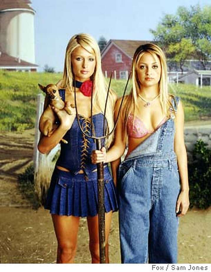 "Paris Hilton, left, and Nicole Richie pose with Tinkerbelle in this undated publicity photo. The Fox reality series ""The Simple Life,"" debuting 8:30 p.m. EST Tuesday, Dec. 2, 2003, drops longtime pals Hilton and Richie into the lap of a Southern farm family. (AP Photo/Fox / Sam Jones) Photo: SAM JONES"
