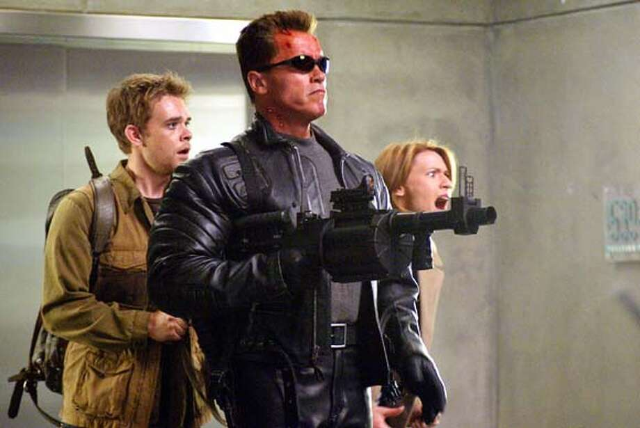 "TERMINATOR3  (L-r) NICK STAHL, ARNOLD SCHWARZENEGGER and CLAIRE DANES in the futuristic action thriller ""Terminator 3: Rise of the Machines,"" distributed by Warner Bros. Pictures.  PHOTOGRAPHS TO BE USED SOLELY FOR ADVERTISING, PROMOTION, PUBLICITY OR REVIEWS OF THIS SPECIFIC MOTION PICTURE AND TO REMAIN THE PROPERTY OF THE STUDIO. NOT FOR SALE OR REDISTRIBUTION Photo: HO"