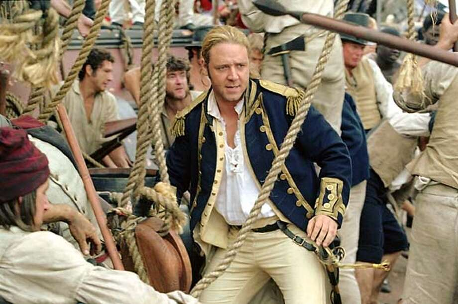 "Russell Crowe portrays Capt.""Lucky"" Jack Aubrey who commands a British navy fighting ship in the new film ""Master and Commander The Far Side of the World"" in a scene from the film in this undated publicity photograph. The film opens November 14, 2003 in the United States. REUTERSStephen Vaughan/20th Century Fox/Handout 0 Photo: HO"