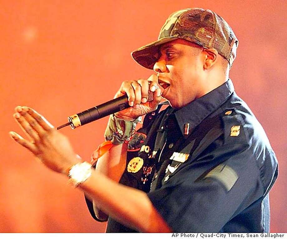 Rapper Jay-Z performs during a stop on the Roc the Mic tour at the Mark of the Quad-Cities in Moline, Ill., Tuesday, July 15, 2003. (AP Photo/Quad-City Times, Sean Gallagher) CAT Photo: SEAN GALLAGHER