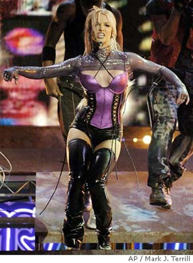 "Britney Spears performs ""Me Against the Music"" during the 31st annual , Sunday, Nov. 16, 2003, in Los Angeles. (AP Photo/Mark J. Terrill) Photo: MARK J. TERRILL"