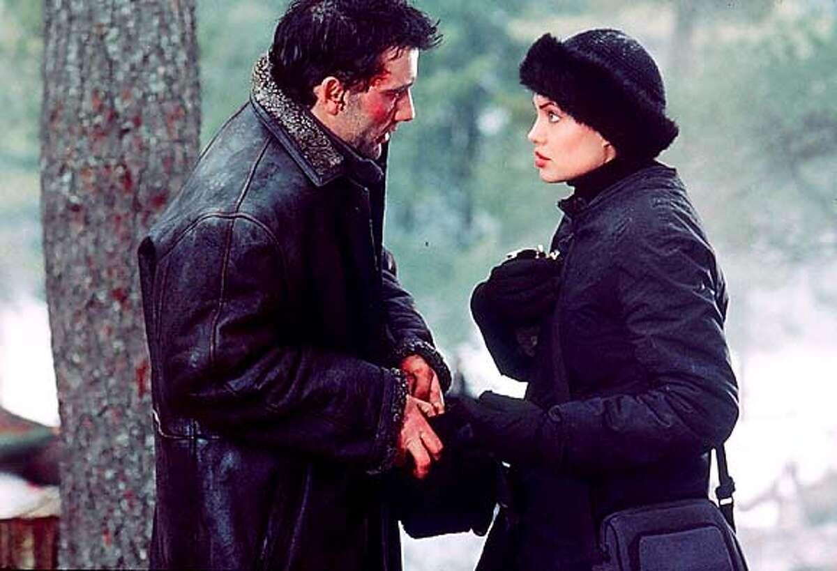 Clive Owen as Nick Callahan and Angelina Jolie as Sarah Jordan in