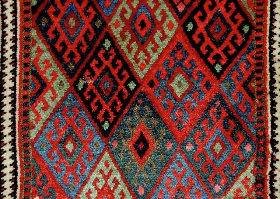 Shiraz Rug Gallery hosts an art and rug show. Photo: Contributed Photo