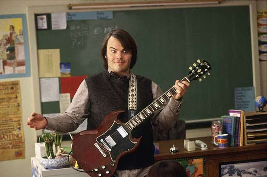 "Actor Jack Black portrays a down and out rock star Dewey Finn who gets fired from his band and who faces a mountain of debts and depression in a scene from his new comedy film ""School of Rock"" in this undated publicity photograph. The film opens September 26 in the United States. REUTERS/Paramount Pictures/Handout Photo: HO"