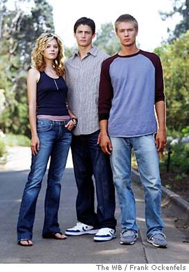 Image #OT-1037  Pictured (left to right): Hilarie Burton as Peyton Sawyer, James Lafferty as Nathan Scott, Chad Michael Murray as Lucas Scott  Photo Credit: � The WB / Frank Ockenfels Photo: HO