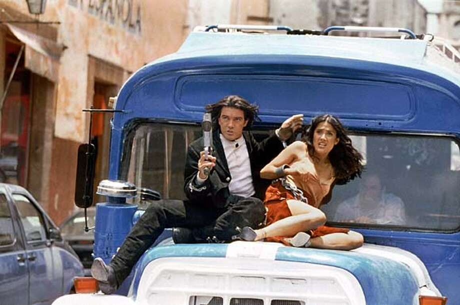"Spanish actor Antonio Banderas and Mexican actress Salma Hayek are shown in a scene from their film "" "" in this undated publicity photograph. Director Robert Rodriguez made the film for about $30 million, utilizing digital technology in his own garage in Texas, giving him the freedom he wants and the studios a film at a lower cost. The film opens September 12, 2003 in the United States. REUTERS/Columbia Pictures/Handout/FEATURE-LEISURE-RODRIGUEZ Photo: HO"