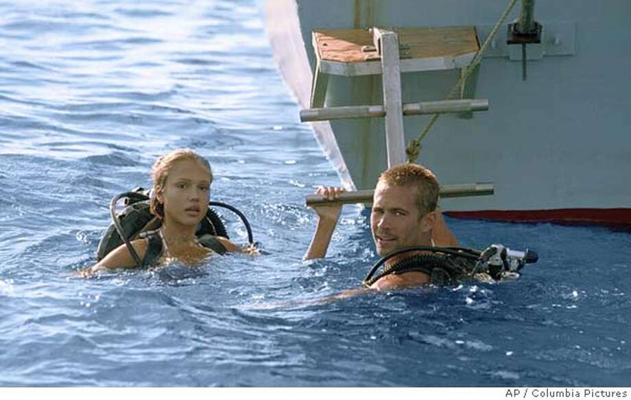 "In this photo provided by Columbia Pictures, Sam (Jessica Alba) and Jared (Paul Walker) are divers that discover a legendary shipwreck rumored to contain millions in gold at the bottom of the sea in "" Into the Blue."" (AP Photo/Columbia Pictures) Photo: JOHN P. JOHNSON"