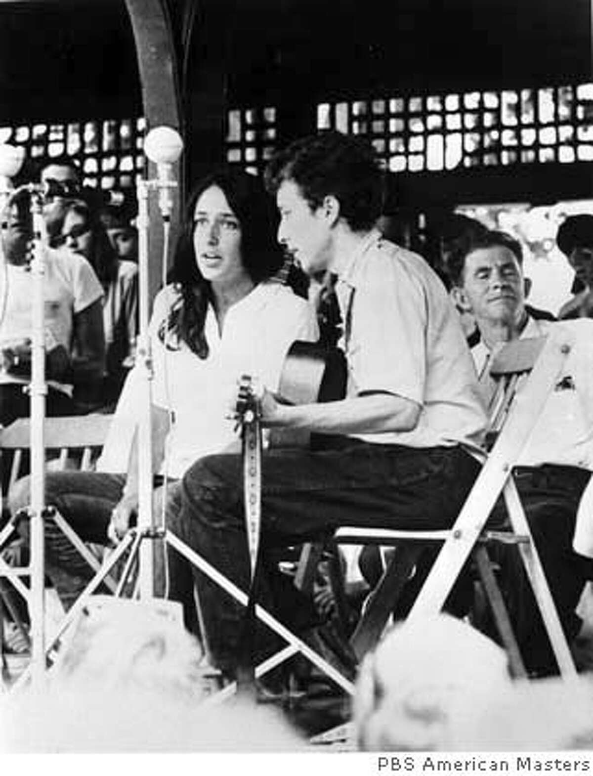 """** EDITORS, LIBRARIANS: PLEASE CORRECT THE CAPTION TO READ """"American Masters,"""" NOT """"American Masterpiece,"""" AS SENT**FILE**Folk singers Joan Baez, left, and Bob Dylan perform at the Newport Jazz Festival in Newport, R.I. in 1963. Dylan is the subject of a documentary film by Martin Scorsese, titled """"No Direction Home: Bob Dylan,"""" which airs as an """"American Masters"""" special at 9 p.m., EDT, Monday and Tuesday on PBS. (AP Photo) A 1963 FILE PHOTO."""