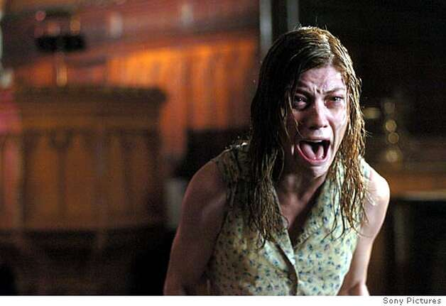 "Actress Jennifer Carpenter is shown in an undated publicity photo released September 7, 2005 in a scene from ""The Exorcism of Emily Rose"", which opens in the USA September 9, 2005. NO ARCHIVE REUTERS/Diyah Pera/Sony Pictures/Handout Photo: HO"