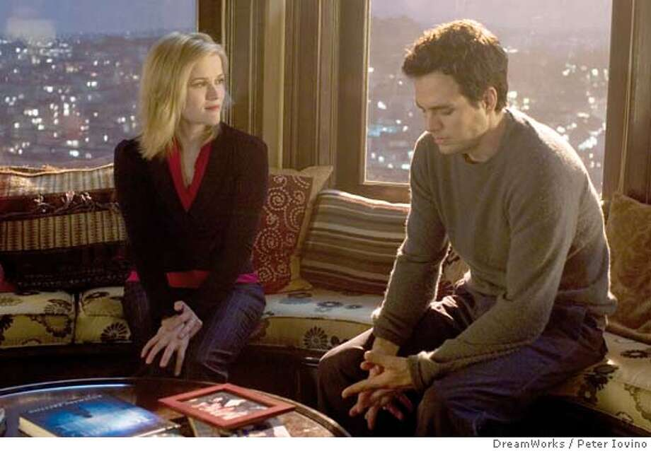 "In this photo provided by DreamWorks, David (Mark Ruffalo) and Elizabeth (Reese Witherspoon) share an intimate moment even though they exist in two different worlds in ""Just Like Heaven."" (AP Photo/DreamWorks/Peter Iovino) Photo: PETER IOVINO"