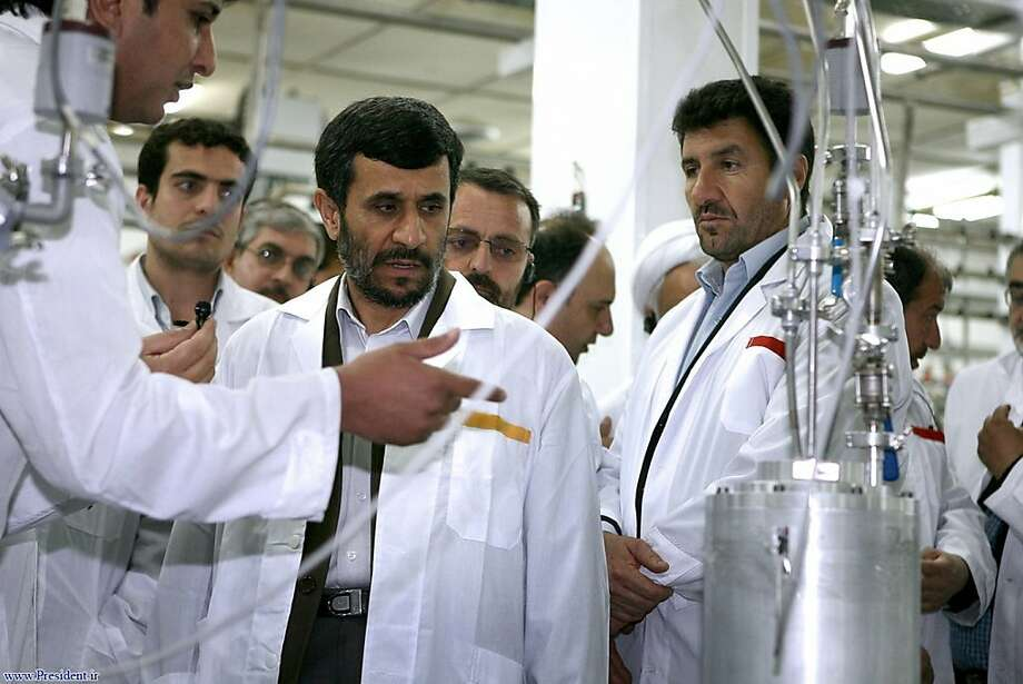 FILE- In this April 8, 2008, file photo released by the Iranian President's Office, Iranian President Mahmoud Ahmadinejad, center, listens to a technician during his visit of the Natanz Uranium Enrichment Facility some 200 miles (322 kilometers) south of the capital Tehran, Iran. Iran said Wednesday, Feb. 15, 2012 it is dramatically closer to mastering the production of nuclear fuel even as the U.S. weighs tougher pressures and Tehran's suspected shadow war with Israel brings probes far beyond the Middle East. (AP Photo/Iranian Presidents office, File) Photo: Associated Press