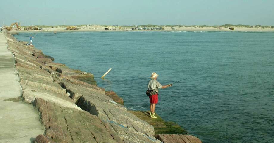 Anglers test the waters at Packery Channel, near Corpus Christi. The coast provides thousands of Texas jobs. An balanced environmental strategy is needed to protect the coast and the state's economy. Photo: File Photo, San Antonio Express-News / SAN ANTONIO EXPRESS-NEWS