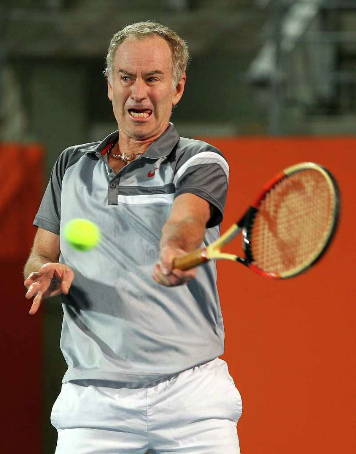 SYDNEY, AUSTRALIA - NOVEMBER 11: John McEnroe of the United States plays a forehand during his match against Wayne Ferreira of South Africa during day one of the Champions Downunder at Sydney Olympic Park Tennis Centre on November 11, 2010 in Sydney, Australia. (Photo by Cameron Spencer/Getty Images for Champions Downunder) champ_111