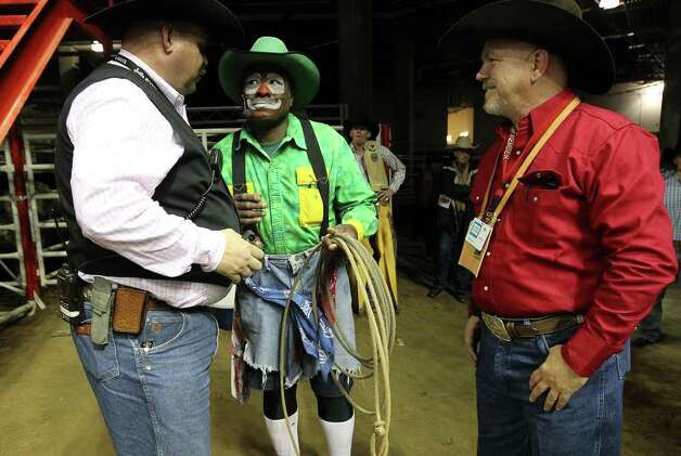 Barrelman Leon Coffee (center) jokes around with rodeo officials before the start of the 2012 San Antonio Stock Show & Rodeo on Tuesday, Feb. 14, 2012. Photo: Kin Man Hui, San Antonio Express-News / San Antonio Express-News