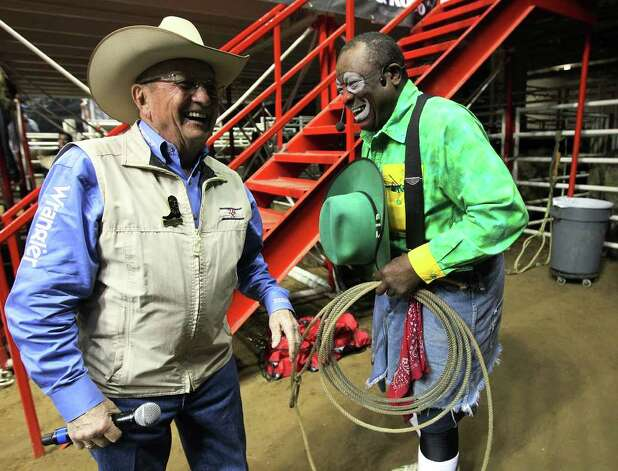 Barrelman Leon Coffee (right) shares a laugh with rodeo announcer Hadley Barrett before the start of the 2012 San Antonio Stock Show & Rodeo on Tuesday, Feb. 14, 2012. Coffee and Barrett play off of one another with humorous banter during the rodeo to keep the crowd entertained between the rodeo action. Photo: Kin Man Hui, San Antonio Express-News / San Antonio Express-News