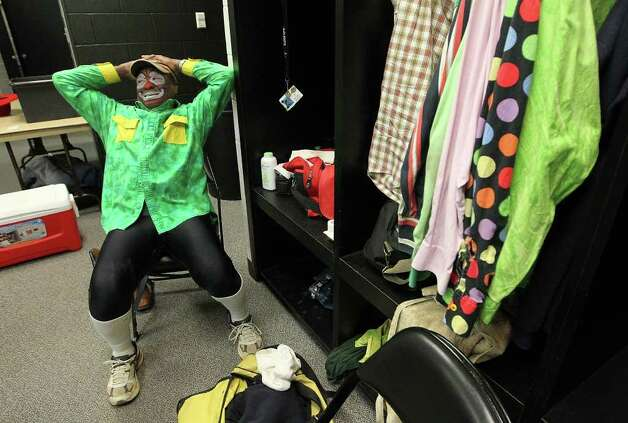 Barrelman Leon Coffee relaxes in the locker room before taking part in another rodeo show at the 2012 San Antonio Stock Show & Rodeo on Tuesday, Feb. 14, 2012. Coffee, 57, has been in the bullfighting business for rodeos since 1969. Photo: Kin Man Hui, San Antonio Express-News / San Antonio Express-News