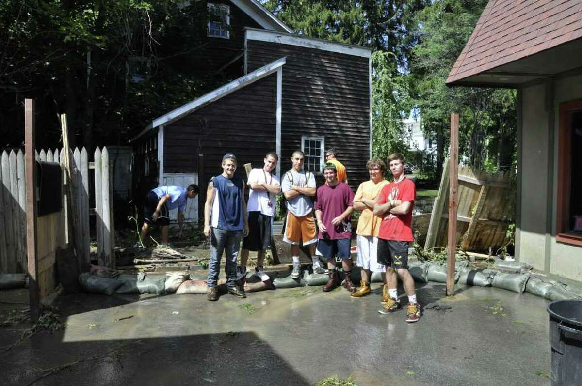 Students from SUNY Cobleskill volunteered to help with local flood relief efforts after Tropical Storms Irene and Lee, as part of the college's Communiversity program. (Photo by Brian Kaiser )