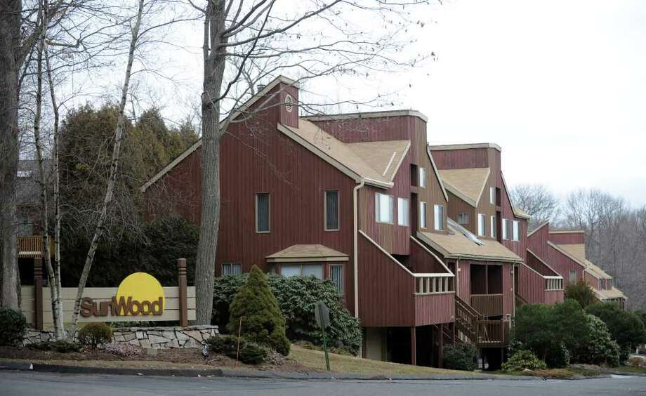 Police say a 46-year-old Bridgeport man was the construction worker who died after falling from the roof of a condominium complex in Shelton on Tuesday Feb. 14, 2012. Authorities identified the man as Francisco Amaral, who worked for a remodeling company in Bridgeport. Police say he was replacing skylights at the Sunwood condominiums when he fell nearly 40 feet. Photo: Autumn Driscoll / Connecticut Post