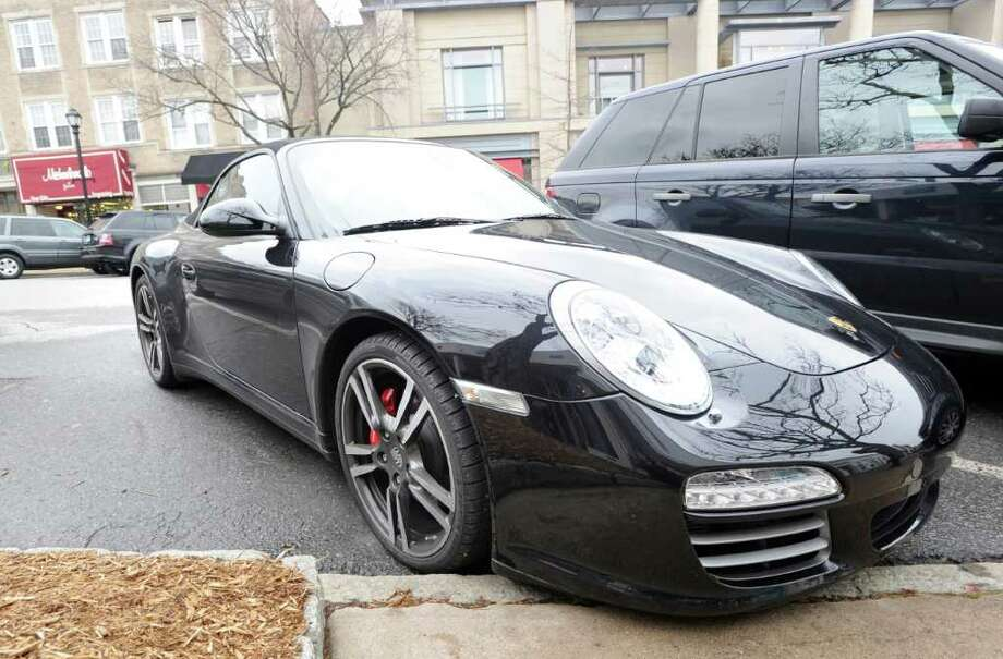 A black Porsche convertible parked on Greenwich Avenue Wednesday, Feb. 15, 2012. Photo: Bob Luckey / Greenwich Time